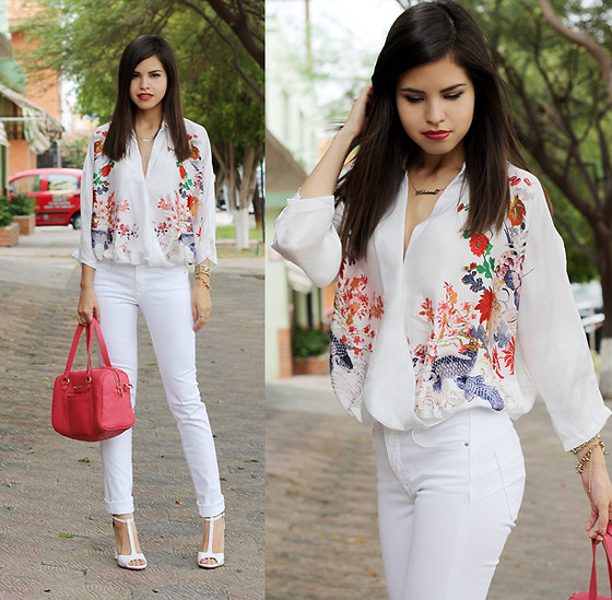 White pants with a white embroidered top accessorized with a pink handbag and killer heels