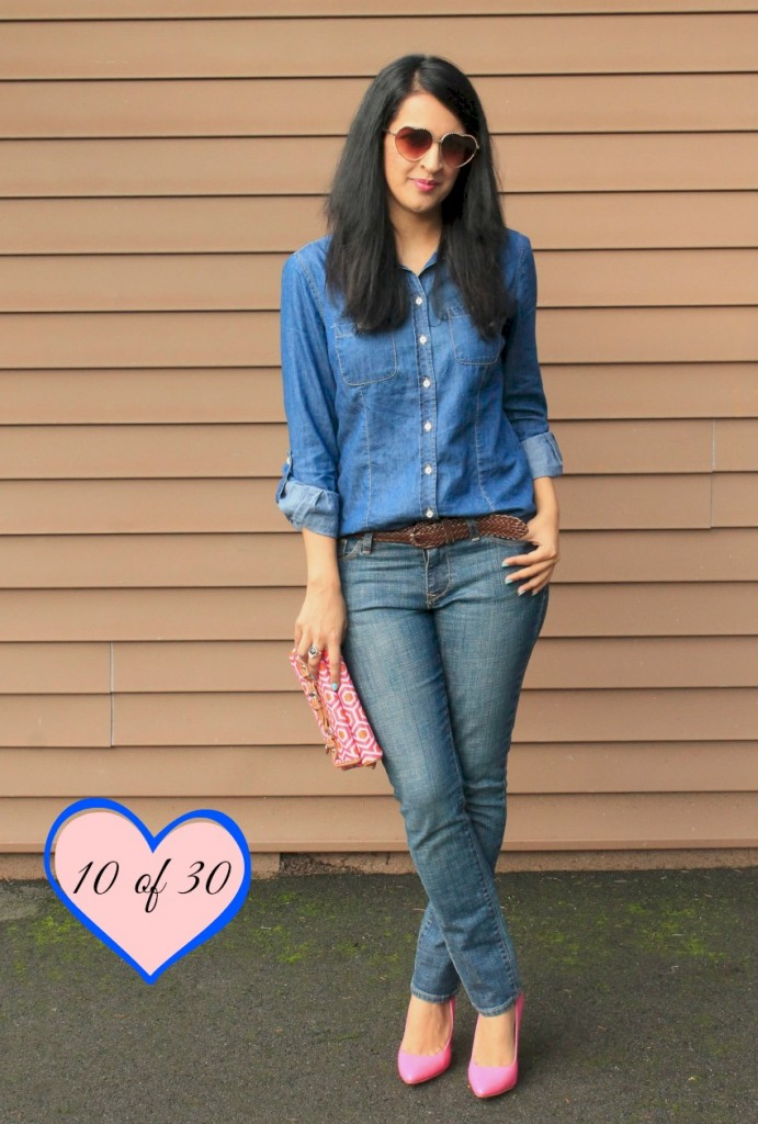 A button down, electric blue top tucked into a washed out blue jeans.